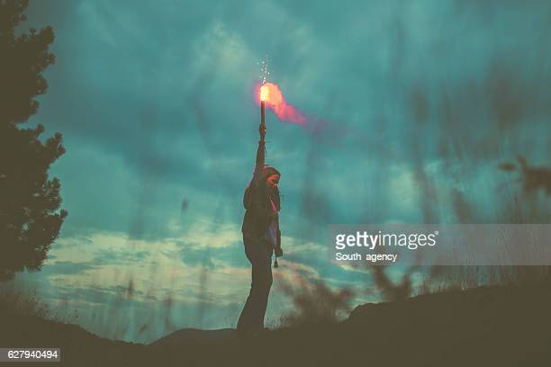 Girl on mountain with torch