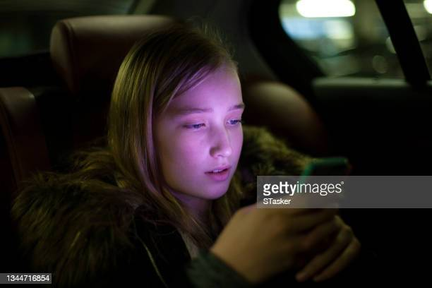 girl on phone in car - st. albans stock pictures, royalty-free photos & images