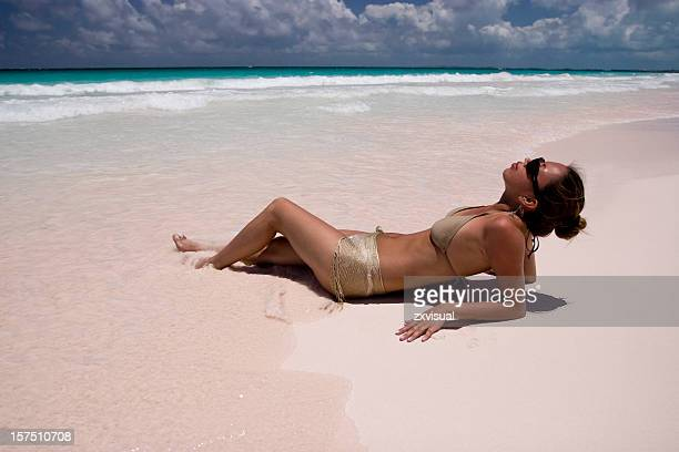 Girl on Pink Sands Beach in Harbour Island Bahamas