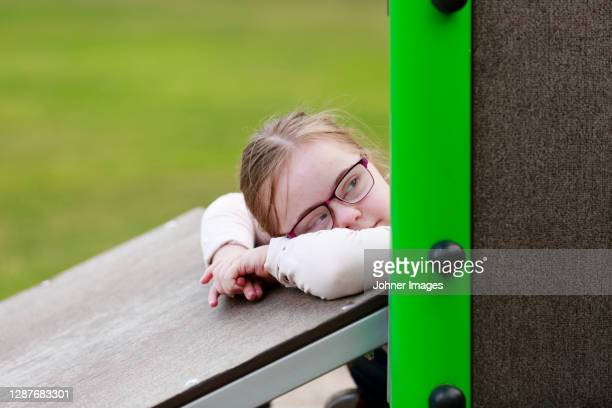girl on playground looking away - leaning disability stock pictures, royalty-free photos & images