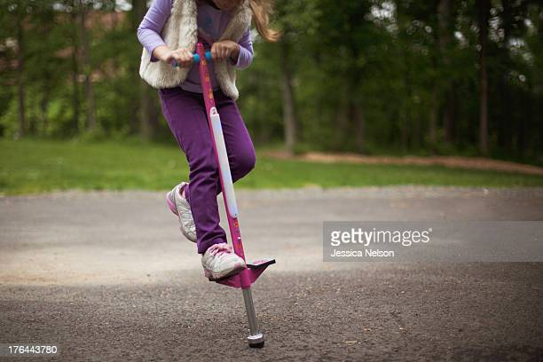 Girl on pogo stick