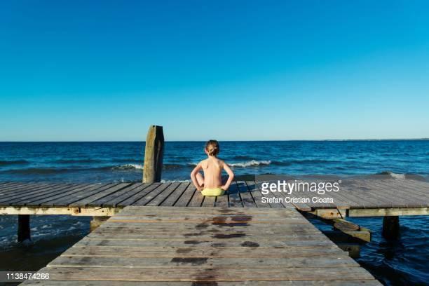 girl on pontoon at the sea, odense, denmark - pontoon bridge stock pictures, royalty-free photos & images
