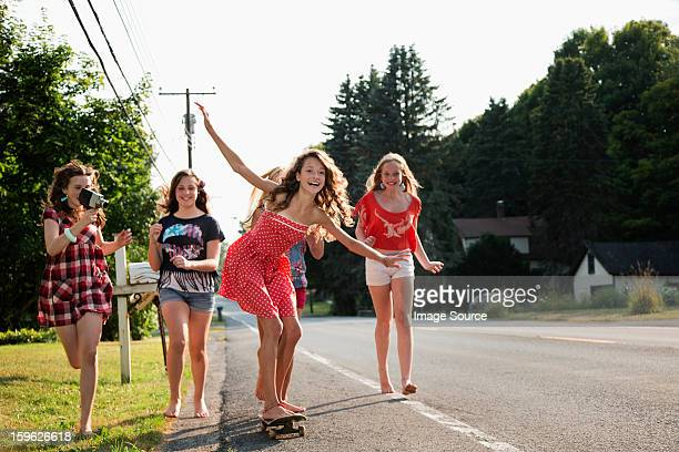 girl on skateboard with friends - camera girls stock photos and pictures