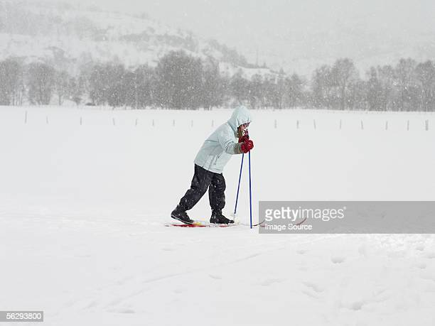 Girl on skis walking in the snow
