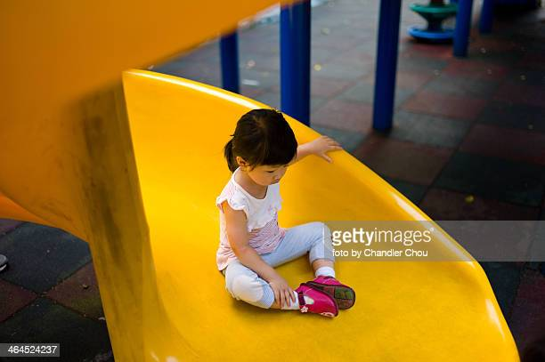 girl on slide - slide play equipment stock pictures, royalty-free photos & images