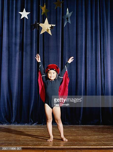 Girl (2-4) on stage in ladybug costume, portrait