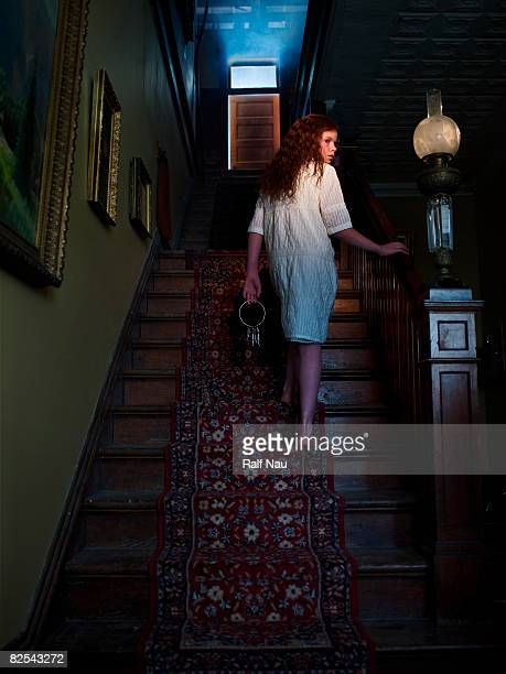 Girl on staircase with keys in her hand