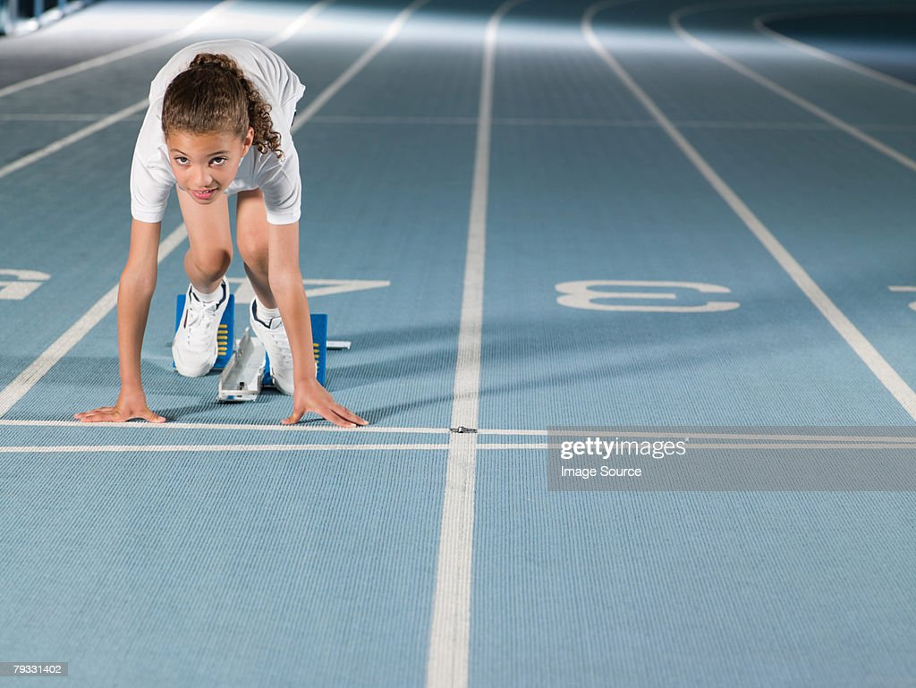 Girl on starting line : Stock Photo
