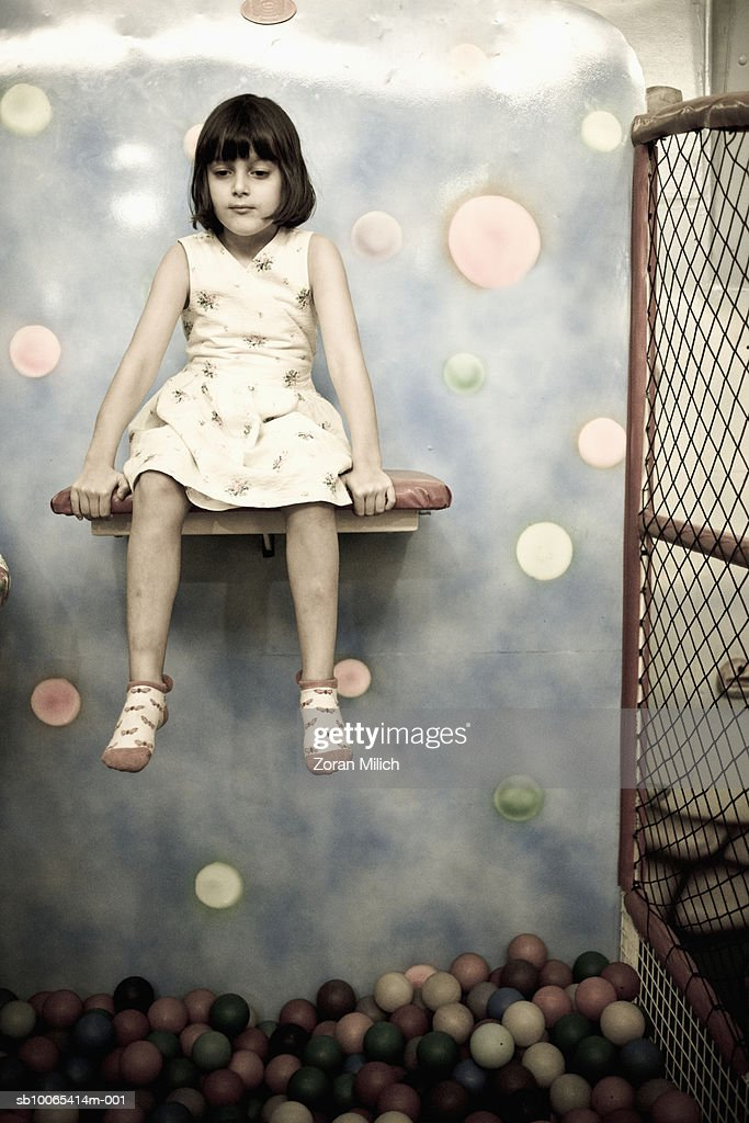 Girl (8-9) on stool : Foto stock