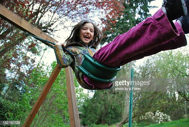 Girl on swing in spring