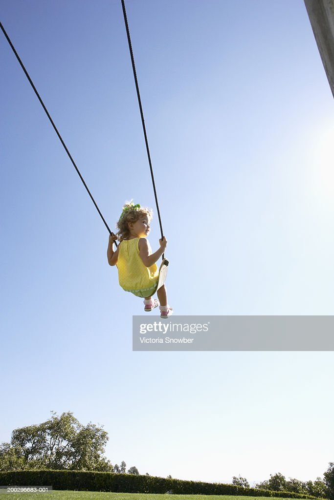 Girl (2-4) on swing : Stock Photo