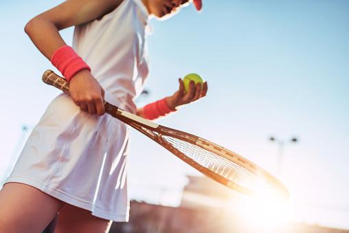 Girl on tennis court. 884670484