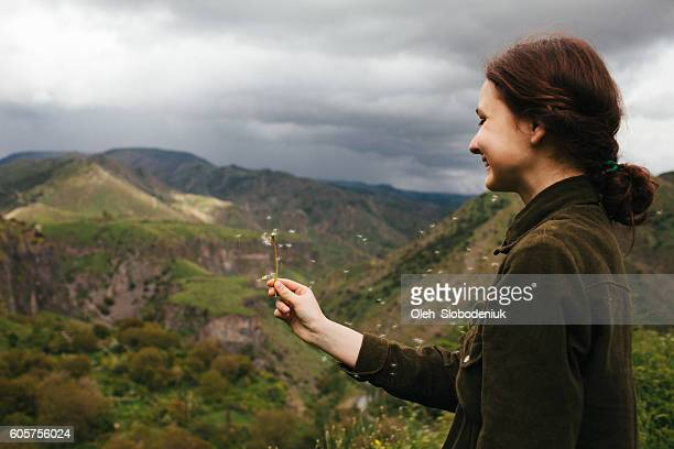 Girl on the background of mountains