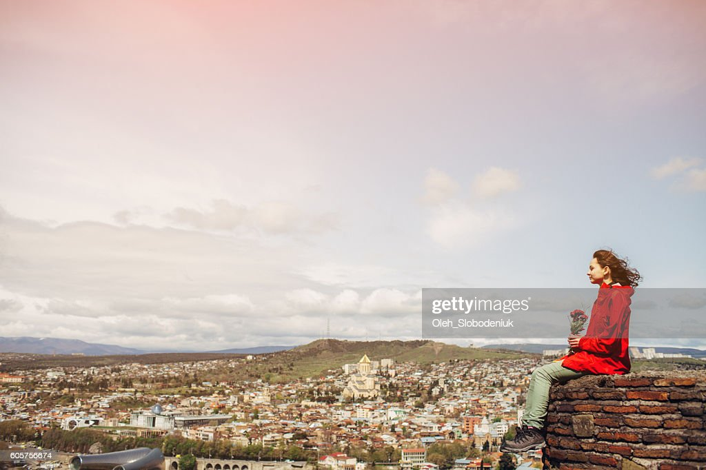 Girl on the background of Tbilisi : Stock Photo