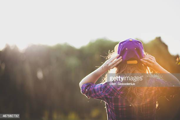 girl on the background of trees - purple hat stock pictures, royalty-free photos & images