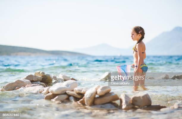 Girl On The Beach Holding Fishing Net