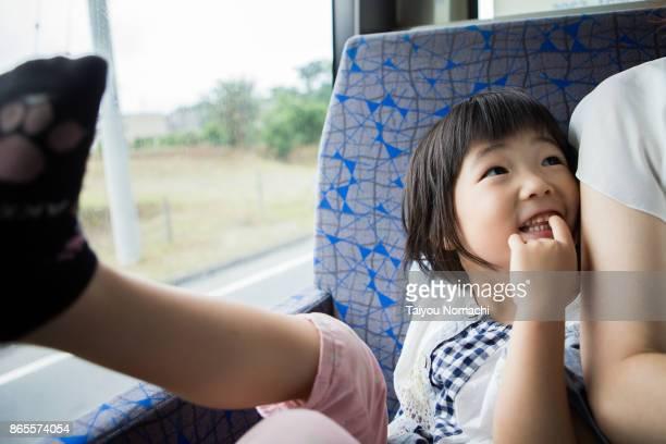 girl on the bus - chiba bus ストックフォトと画像