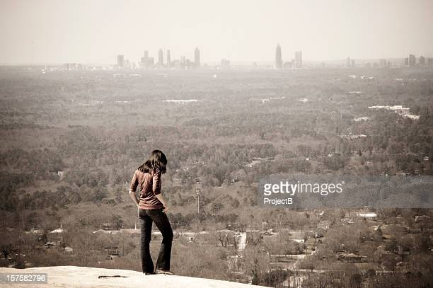 girl on the edge of cliff - atlanta georgia stock photos and pictures