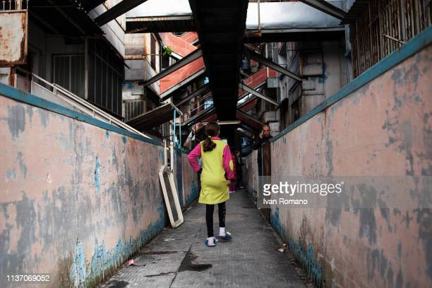 A girl on the gallery inside the Yellow Sail on November 15 2016 in Naples Italy The Brutalist apartment blocks known as Le Vele or 'The Sails Of...