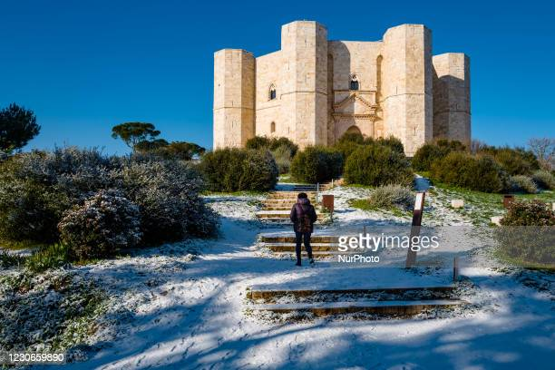 Girl on the hill leading to the snowy Castel del Monte on January 18, 2021. The cold wave continues in Puglia, another night below zero in part of...