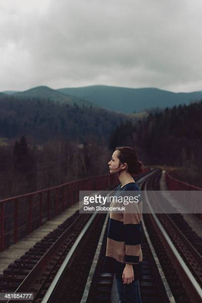 Girl on the railway bridge