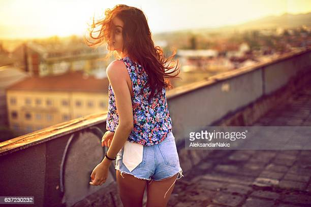 girl on the rooftop - denim shorts stock pictures, royalty-free photos & images