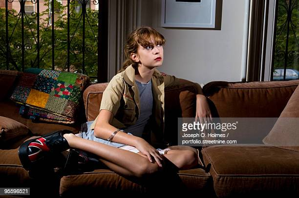 girl on the sofa - joseph o. holmes stock pictures, royalty-free photos & images