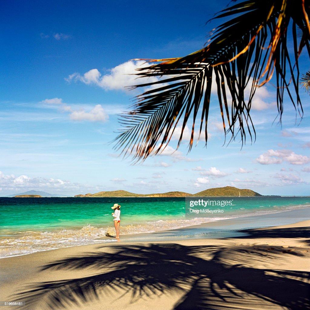 Beach Island: Girl On The Tropical Island Beach Stock Photo