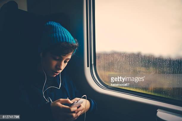 Girl on Train using smartphone