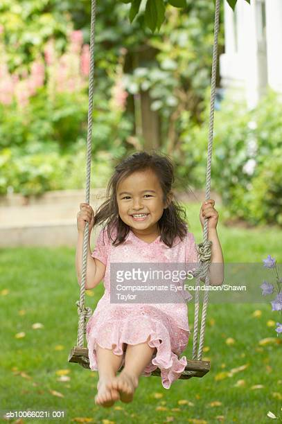 """girl (6-7) on tree swing, portrait - """"compassionate eye"""" stock pictures, royalty-free photos & images"""