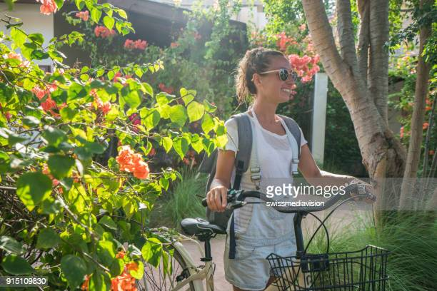girl on vacations using bicycle - gili trawangan stock photos and pictures