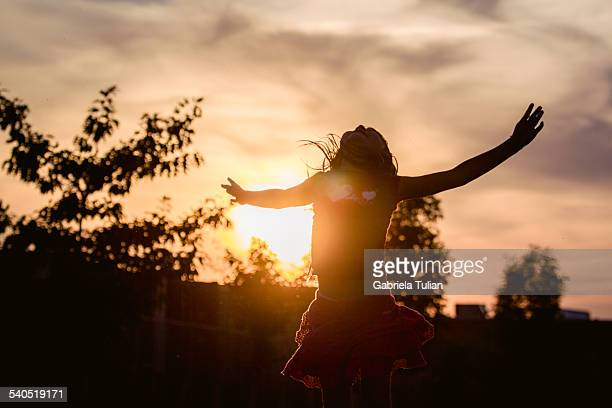 Girl opening her arms to heaven