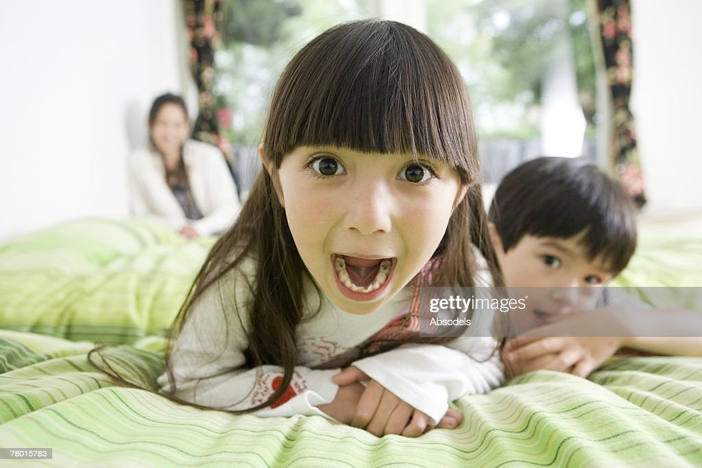 Girl opening mouth : Stock Photo