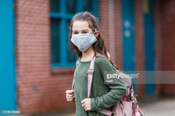 girl outside elementary school wearing face mask - long sleeved stock pictures, royalty-free photos & images