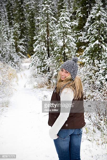 Girl outside in winter, rear view