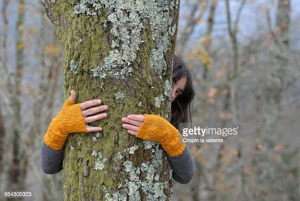 girl over the tree - tree hugging stock pictures, royalty-free photos & images