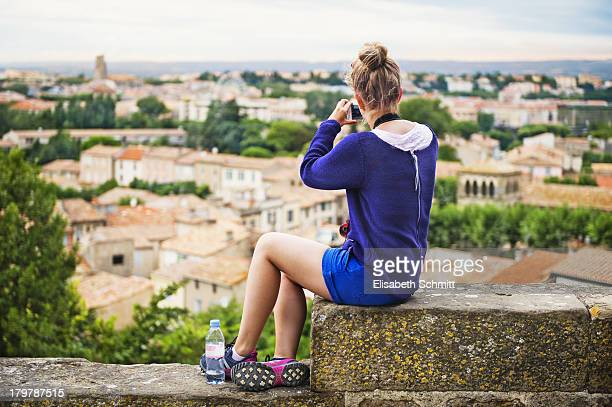 Girl overlooking Carcassonne and taking images