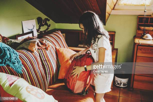 girl packing books in order to go to school - girl mound stock pictures, royalty-free photos & images