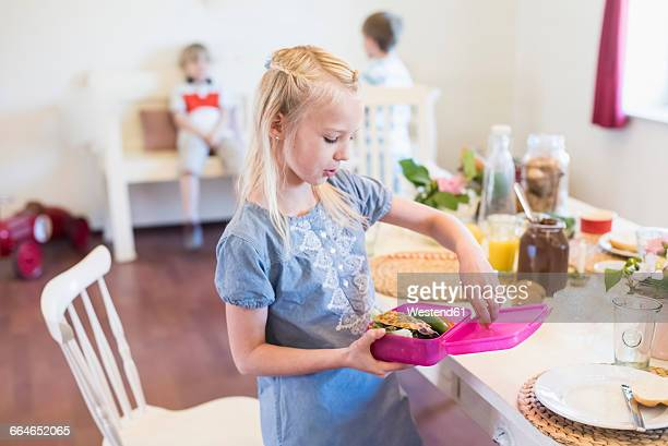 Girl packing lunch box