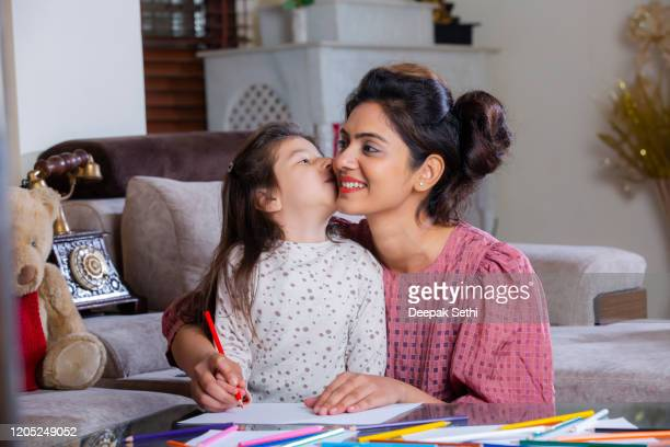 girl painting drawing with her mother stock photo - images stock pictures, royalty-free photos & images