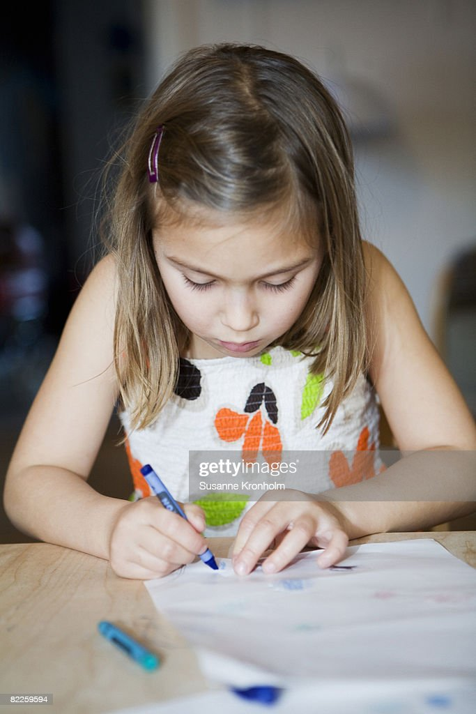 A girl painting on a paper Sweden. : Stock Photo