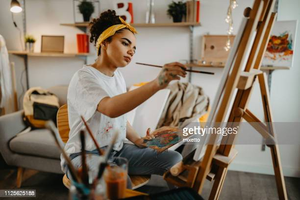 girl painting on canvas - adult photos stock pictures, royalty-free photos & images