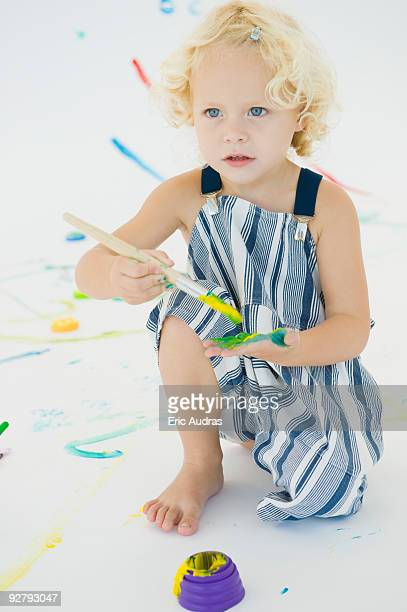 Girl painting on her palm