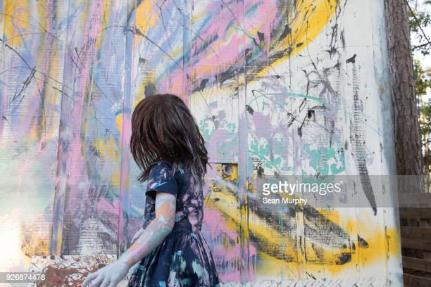 girl painting wall - children art stock photos and pictures