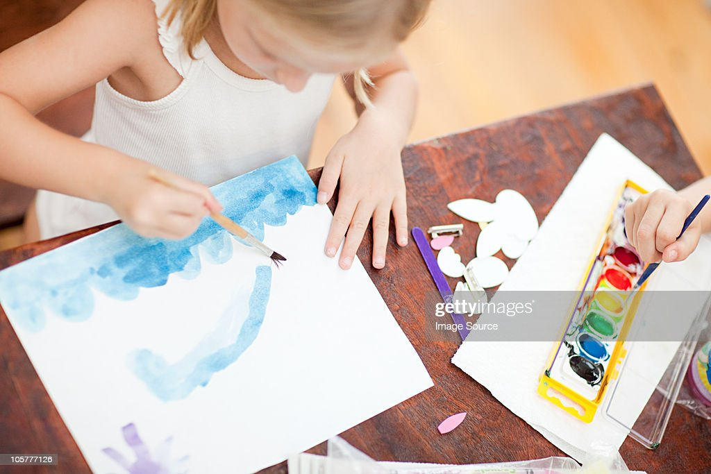 Girl painting with watercolors : Stock Photo