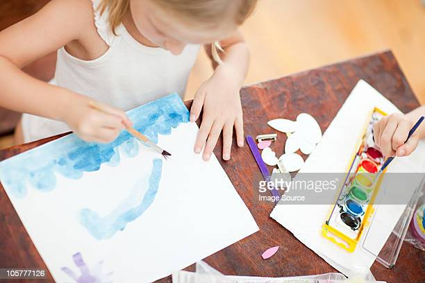Girl painting with watercolors