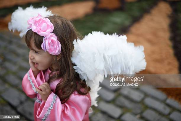 Girl participates in an Easter Sunday procession representing the resurrection of Christ, in the Brazilian historic city of Ouro Preto, Minas Gerais...