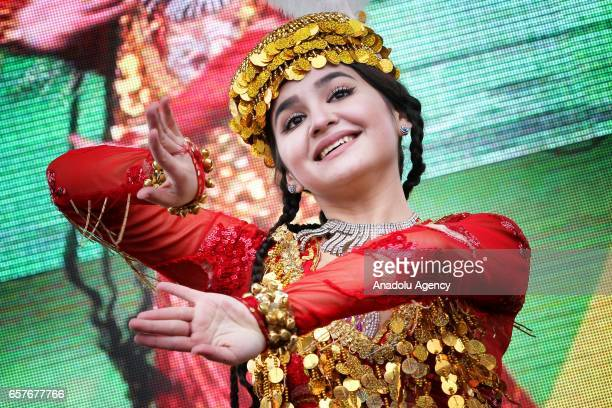 A girl participates in Nowruz celebrations with traditional costumes in Kazan Russia on March 25 2017 International Nowruz Day which marks the first...