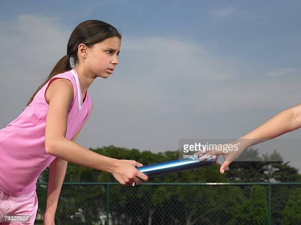 A girl passing the baton