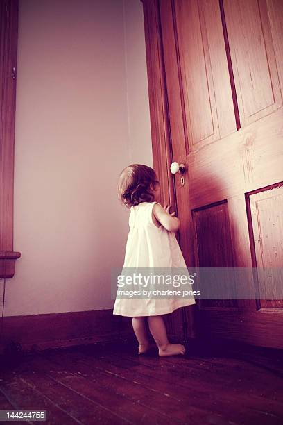 Girl peeking in keyhole